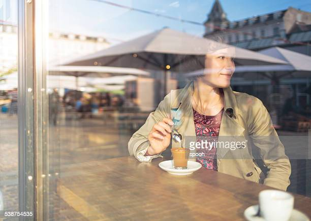 Woman with coffee in cafe in Copenhagen