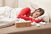 Woman with cold sleeping