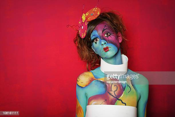 Woman With Colorful Body Paint Posing on Pink Background
