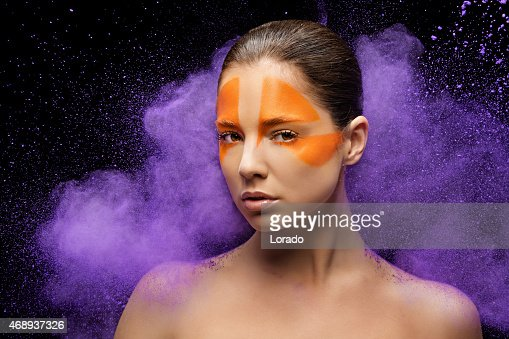woman with colourful make-up in the powder cloud
