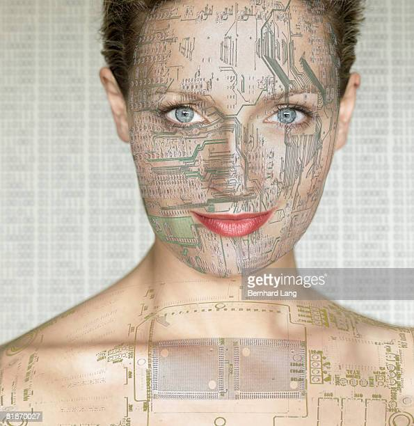 Woman with computer circuit board lines on face