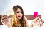 Woman with contraceptive pills and condom