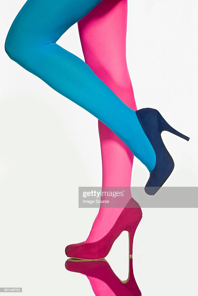 Woman with contrasting tights and shoes