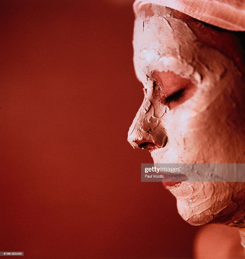 Woman With Cosmetic Face Mask : Stock Photo