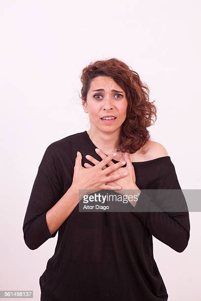 Woman with crossed  hands over her chest.
