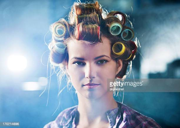 Woman with curlers on her head.