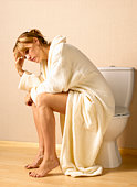 Woman with depression on toilet seat
