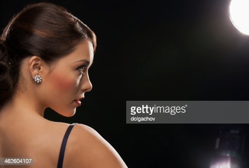 woman with diamond earrings : Stock Photo