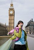 Woman with digital camera by Big Ben, London, England