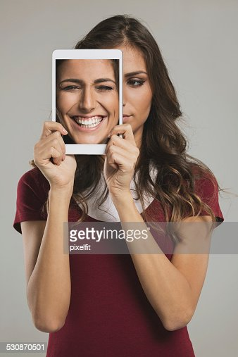 Woman with digital tablet and different faces