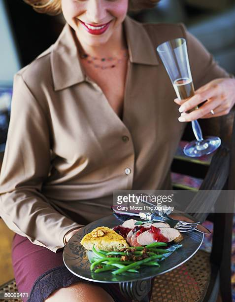 Woman with dinner and wine