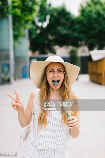 Woman with discolored tongue holding ice cream cone