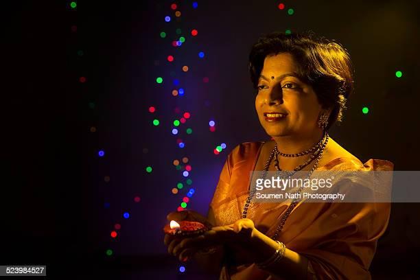 Woman with diya on Diwali