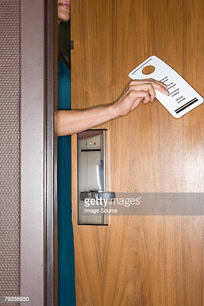 Woman with do not disturb sign