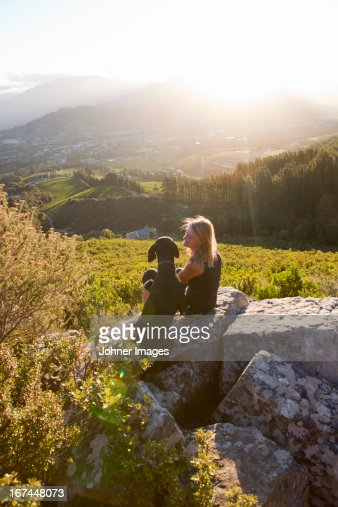 Woman with dog at sunset : Stock Photo