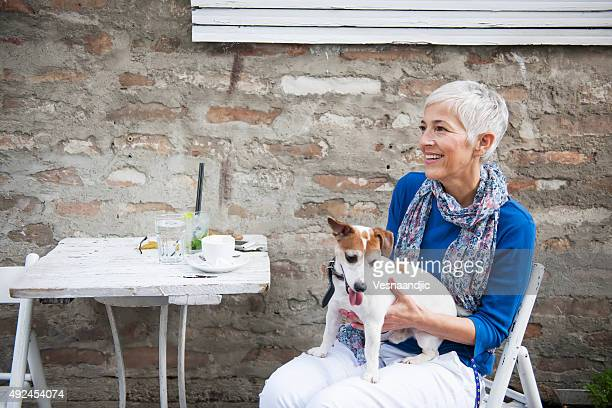Woman with dog at the cafe
