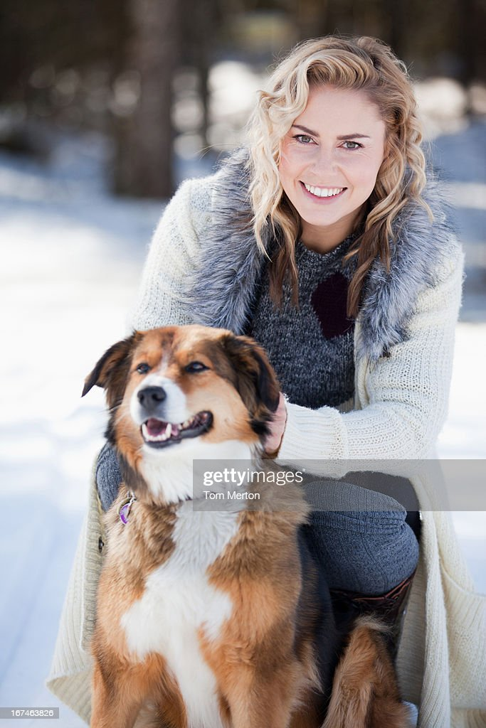 Woman with dog in snow : Stock Photo