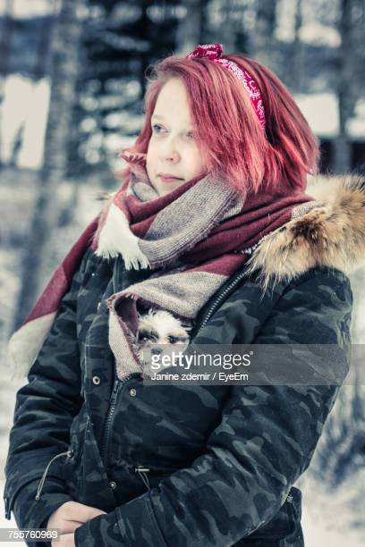Woman With Dog In Winter Coat Looking Away