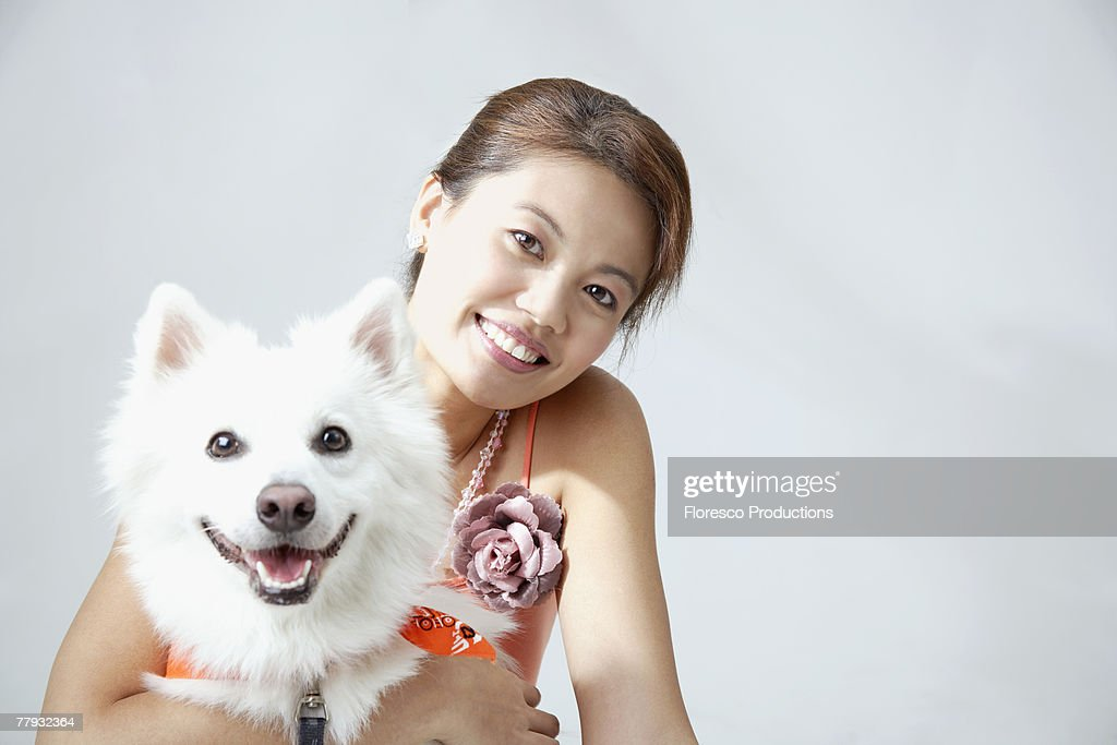 Woman with dog indoors : Stock Photo