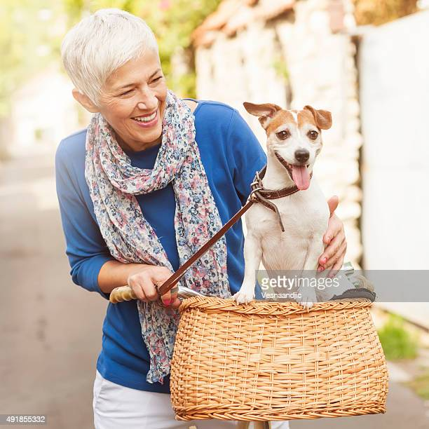 Woman with dog on bicycle