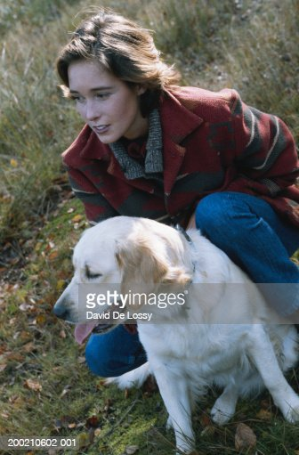 Woman with dog outdoors, portrait : Stock Photo