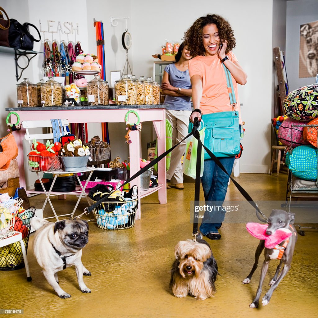 Woman with Dogs in Pet Store