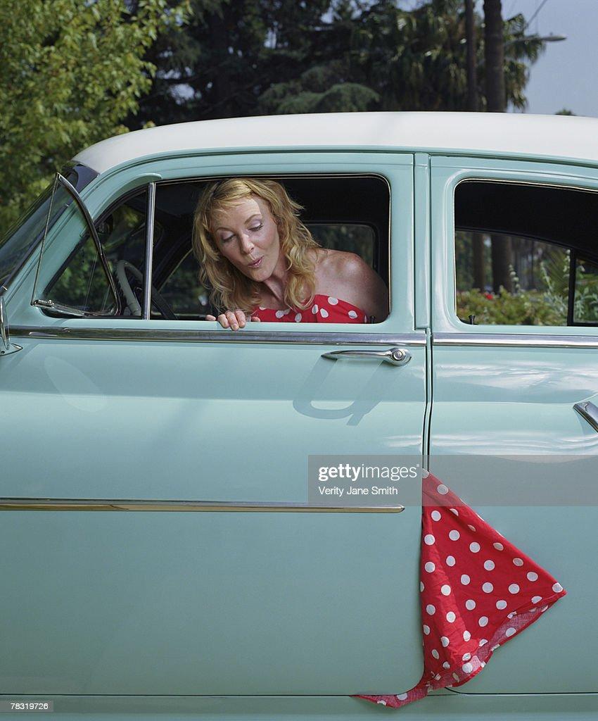 Woman with dress caught in car door