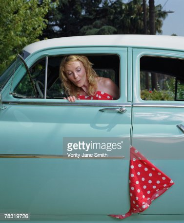 Woman with dress caught in car door : Stock Photo