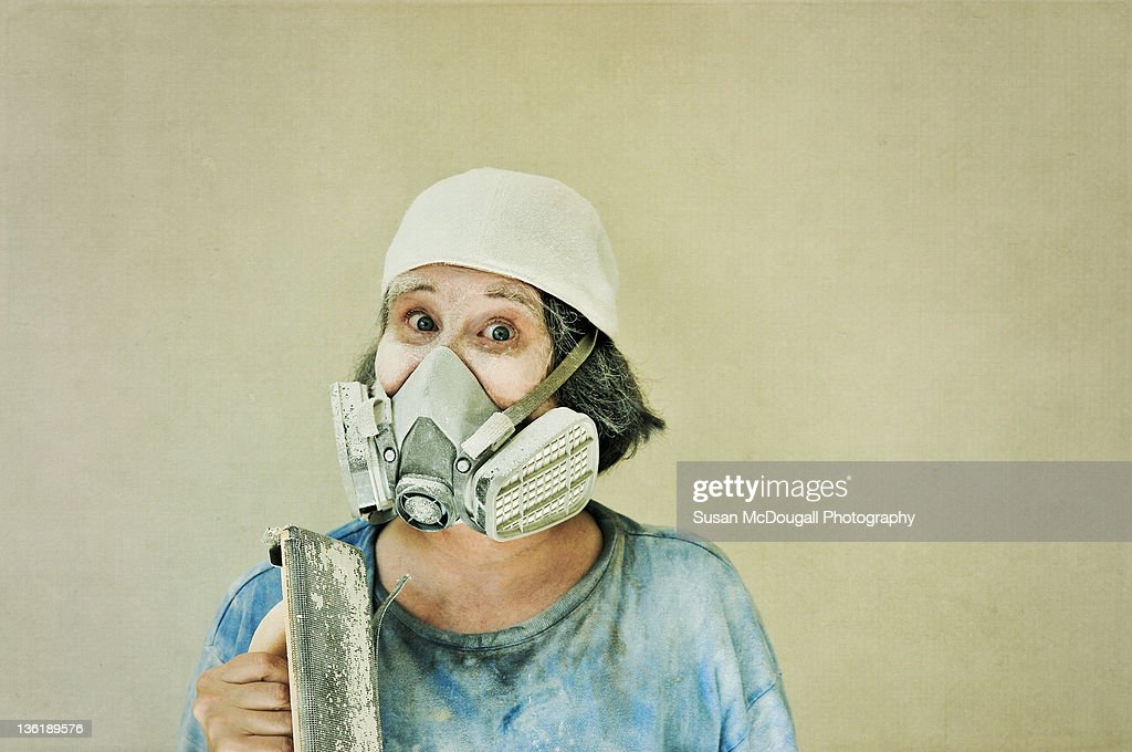 Woman with drywall sanding tool : Stock Photo