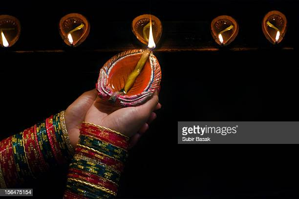 Woman with earthen lamp at Diwali