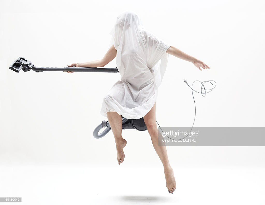 woman with electric broom stick. : Stock Photo