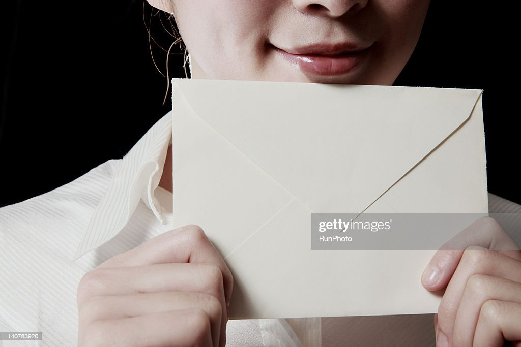 woman with envelope,close-up