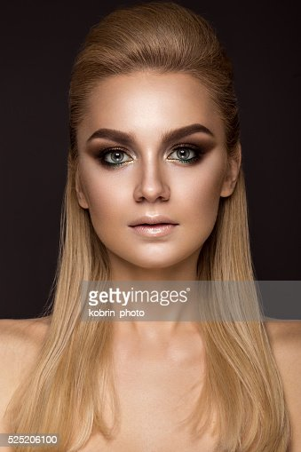 woman with evening makeup, long straight hair . Smoky eyes. : Stock Photo