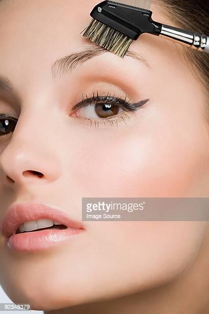 Woman with eyebrow brush