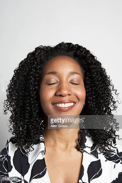 Woman with eyes closed, portrait
