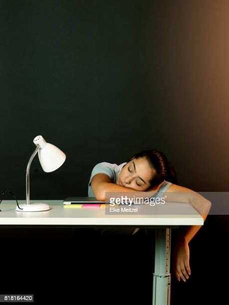woman with eyes closes at her desk