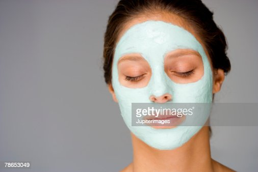 Woman with facial mask : Stock Photo