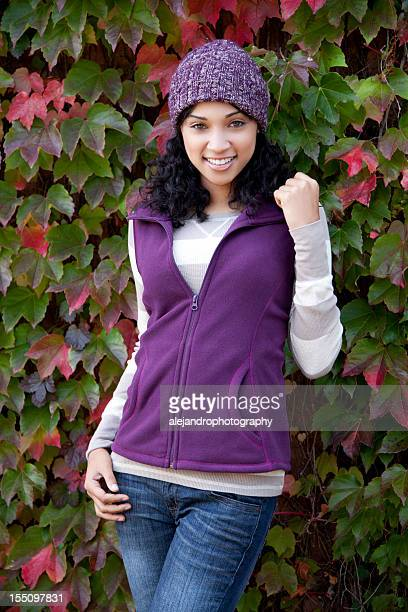 Woman with fall outfit smiling