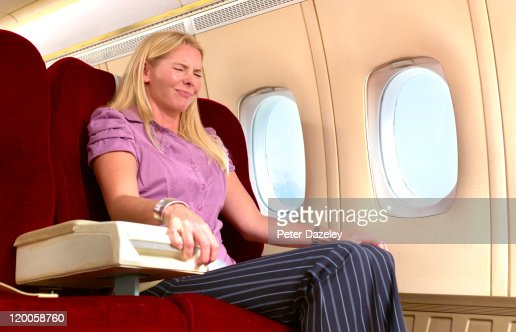 Woman with fear of flying : Stock Photo