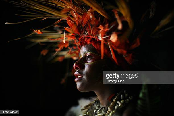 Woman with feather and grass headdress