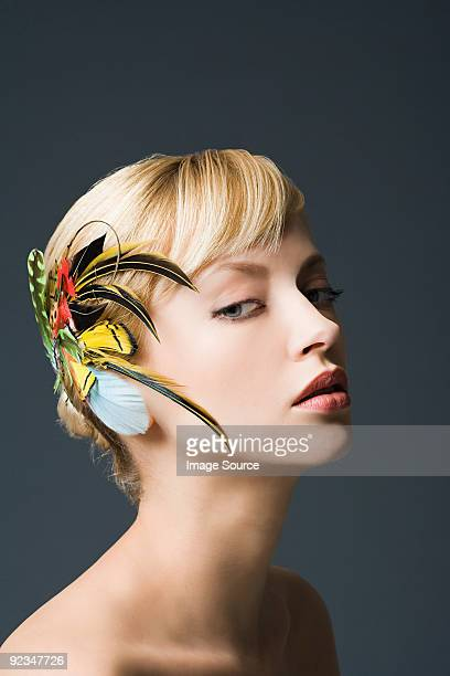 Woman with feather fascinator in hair
