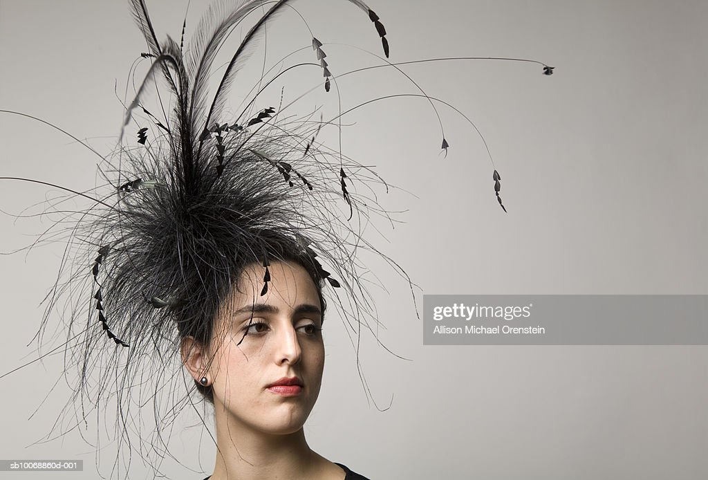 Woman with feather hairdress, close-up : Stock Photo
