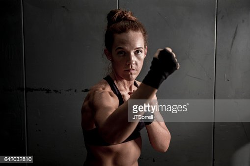 Woman with Fists Raised