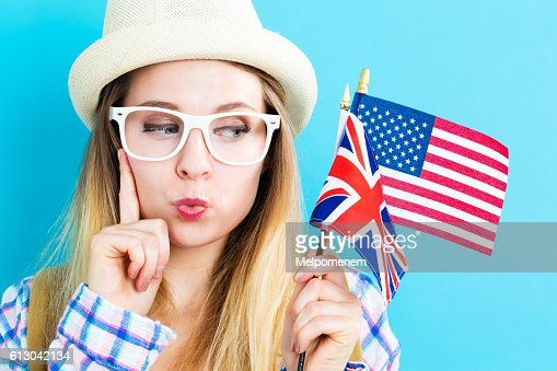 Woman with flags of English speaking countries : Stock Photo