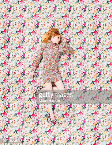 woman with floral print on floral background