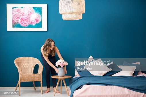 Woman with flowers at home : Stock Photo