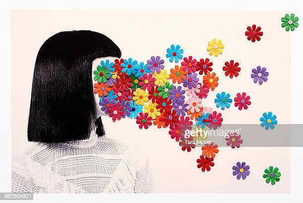 woman with flowers covering face