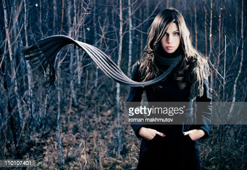 Woman with flying scarf : Stock Photo