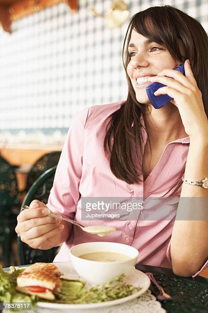 Woman with food and cell phone