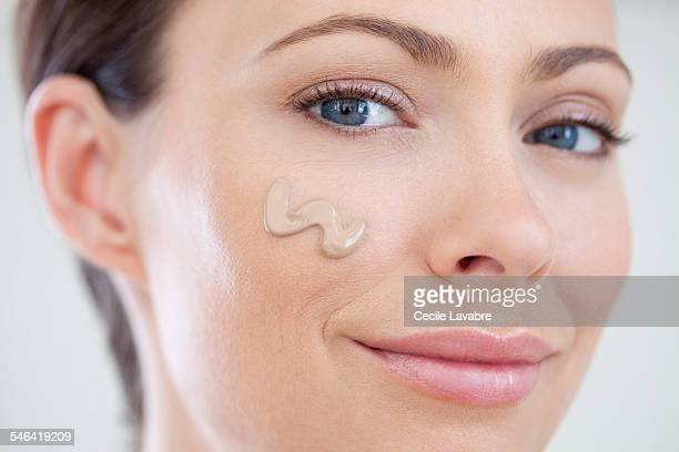 Woman with foundation on cheek